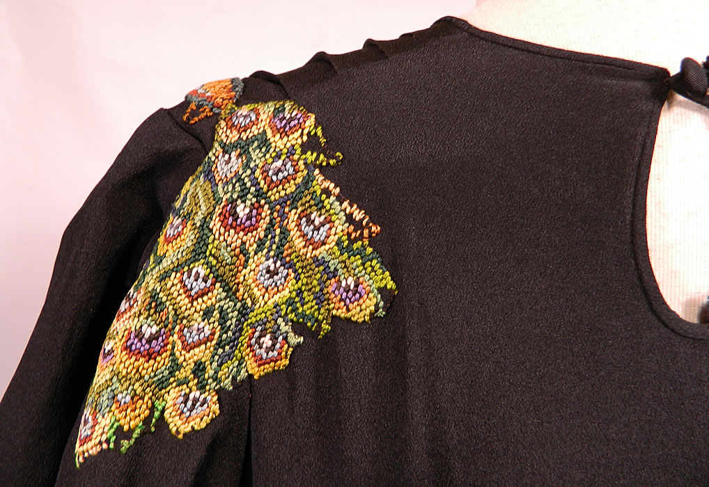 Vintage Black Silk Crepe Peacock Embroidered Needlepoint Maxi Dress Gown. The dress measures 57 inches long, with 38 inch hips, a 30 inch waist, 38 inch bust and 27 inch long sleeves. It is in good condition, with only some fraying on the inside top silk lining. This is truly a rare and exceptional quality made piece of wearable art!