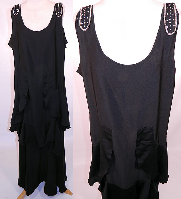 Vintage Art Deco Black Silk Crepe Ruffle Rhinestone Beaded Flapper Dress. This Art Deco vintage black silk crepe ruffle rhinestone beaded flapper dress dates from the 1920s. It is made of a black silk crepe de chine fabric, with rhinestone beading on the shoulder straps and back neckline.