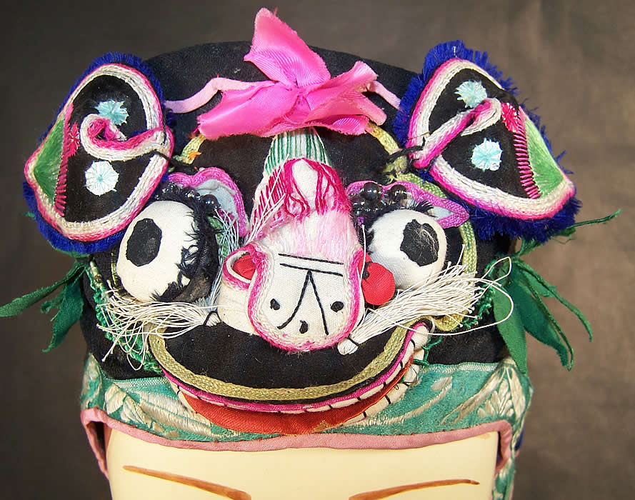 Chinese Child Infant Silk Applique Tiger Wind Hat close-up view.