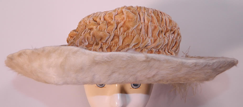 Edwardian Titanic Cream Velvet White Beaver Felt Fur Feather Wide Brim Hat. It is made of a ecru cream color ruched pleated gathered silk velvet fabric crown and an off white plush beaver felt fur fabric brim.