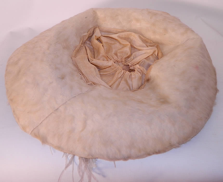 Edwardian Titanic Cream Velvet White Beaver Felt Fur Feather Wide Brim Hat. It is lined inside the crown in white cotton. The hat measures 24 inches inside crown circumference and is 47 inches outside.