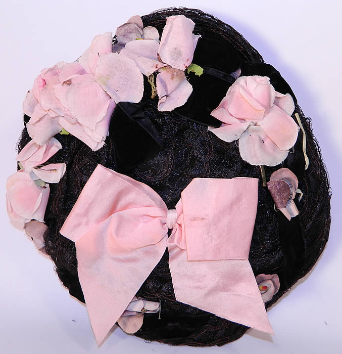 Victorian Black Straw Pink Pansy Rose Flower Bow Trim Bonnet Flat Plate Hat. The bonnet measures 31 inches in circumference and 10 inches across. It is in good condition.