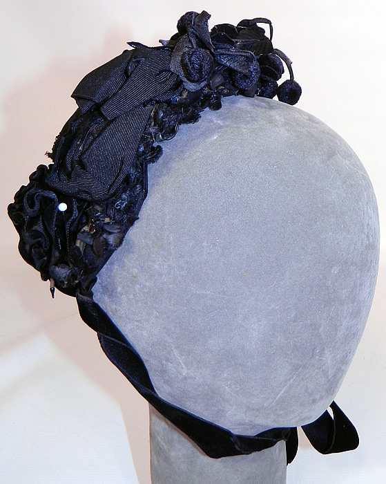 Victorian Black Silk Jet Beaded Trim Paris Label Mourning Bonnet Hat. It is made of a black silk fabric base, covered with a sheer black net  and jet beading.