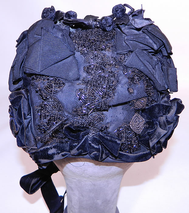 Victorian Black Silk Jet Beaded Trim Paris Label Mourning Bonnet Hat. There are black  silk velvet floral ball trim  and  black silk grosgrain ribbon bow trim on top.