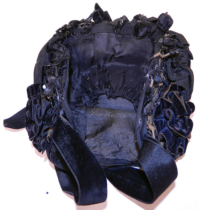Victorian Black Silk Jet Beaded Trim Paris Label Mourning Bonnet Hat. The bonnet measures 13 inches around the face. It is in good condition, with some fraying of the net back, missing beading and some wear to the velvet nap around the edges. This is truly a wonderful piece of wearable millinery art!