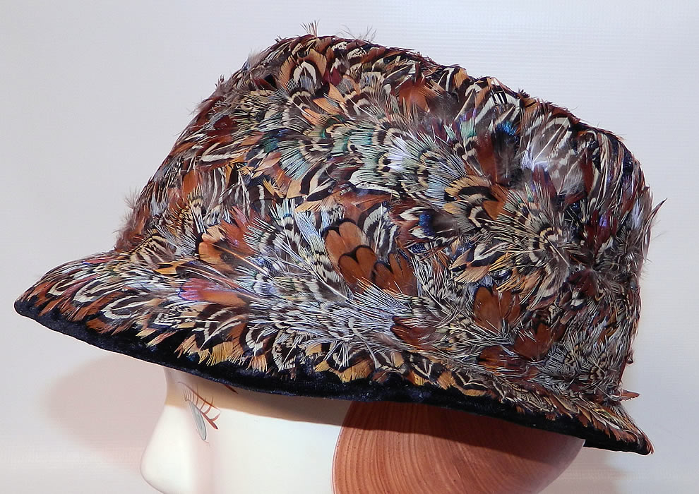 Vintage Womens Black Velvet Pheasant Feather Fedora Hat. It is made of a black velvet fabric base, covered with a variety of colorful pheasant bird feathers.