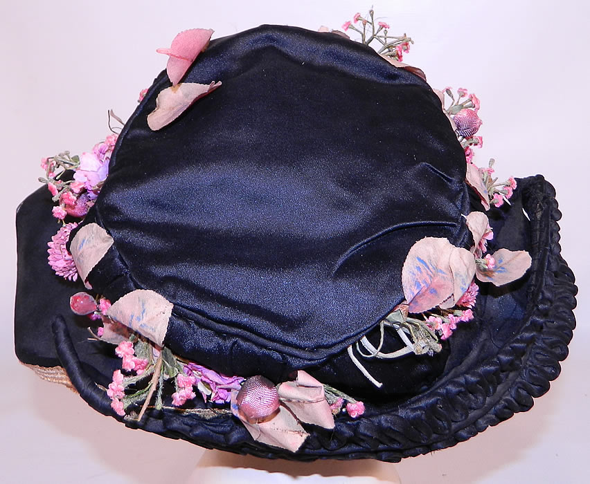 Edwardian Black Silk & Natural Straw Floral Garland Trim Wide Brim Hat. It is lined in a black silk fabric. The hat measures 22 inches inside crown circumference.