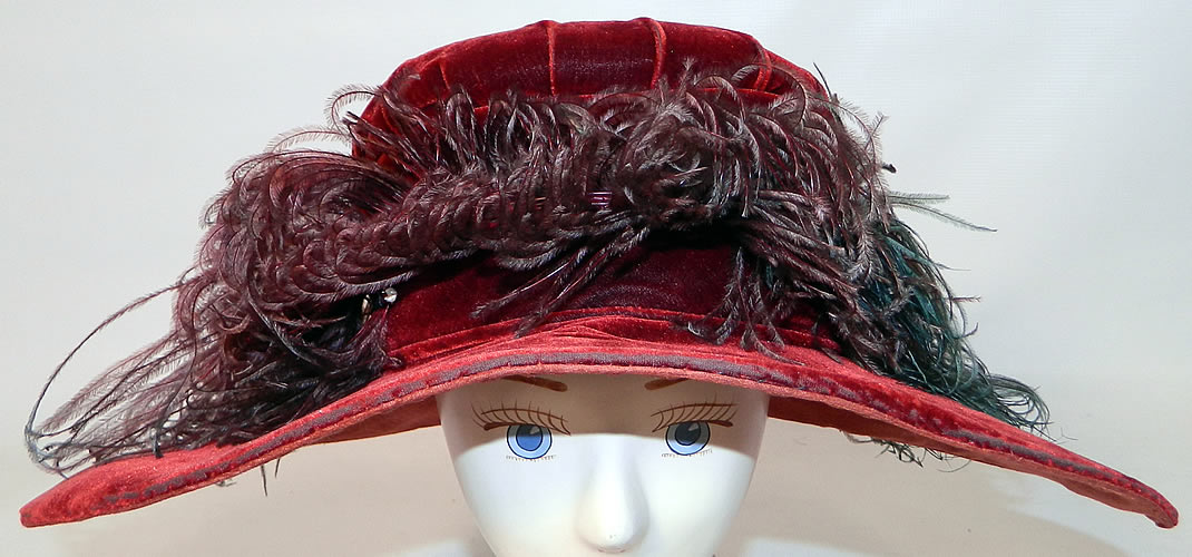 Vintage Fall Color Burgundy Red Velvet Feather Boa Trim Wide Brim Cloche Hat. This vintage fall color burgundy red velvet feather boa trim wide brim cloche hat dates from  the 1920s.