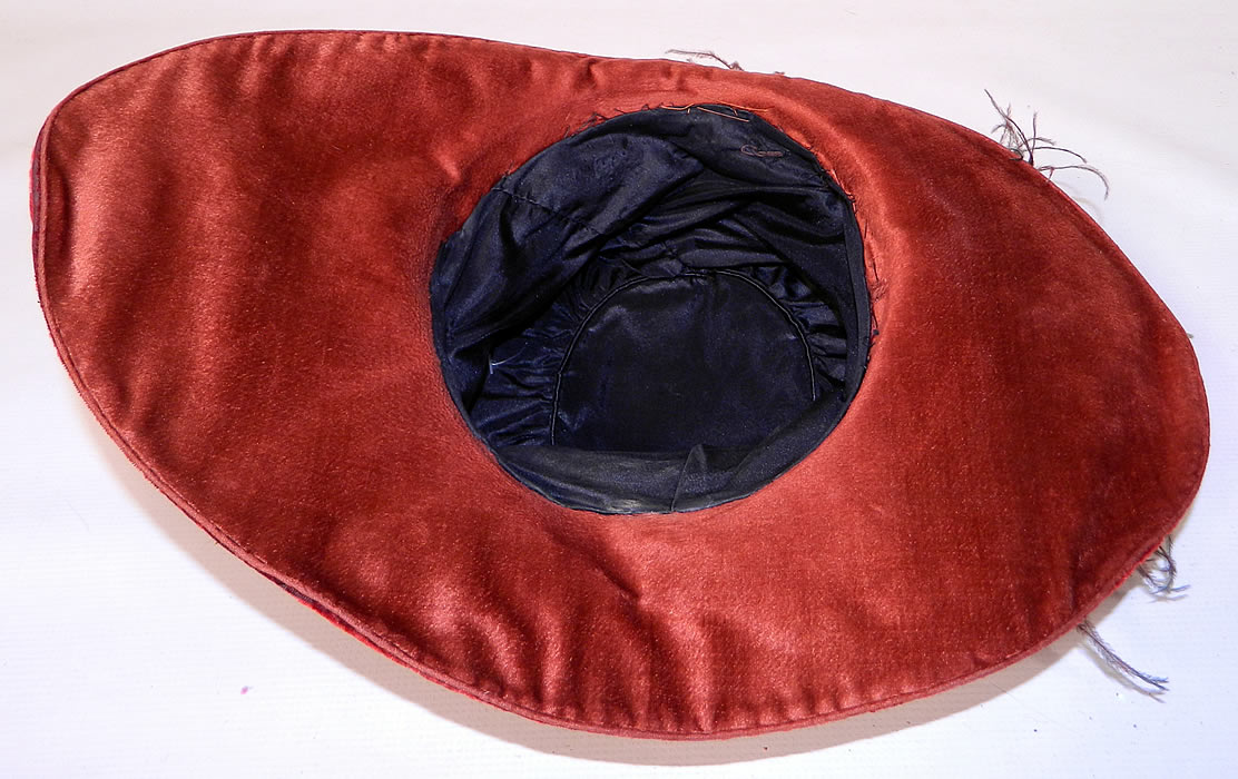 Vintage Fall Color Burgundy Red Velvet Feather Boa Trim Wide Brim Cloche Hat.  It is fully lined inside with black silk fabric. This is truly a wonderful piece of quality made wearable textile millinery art!