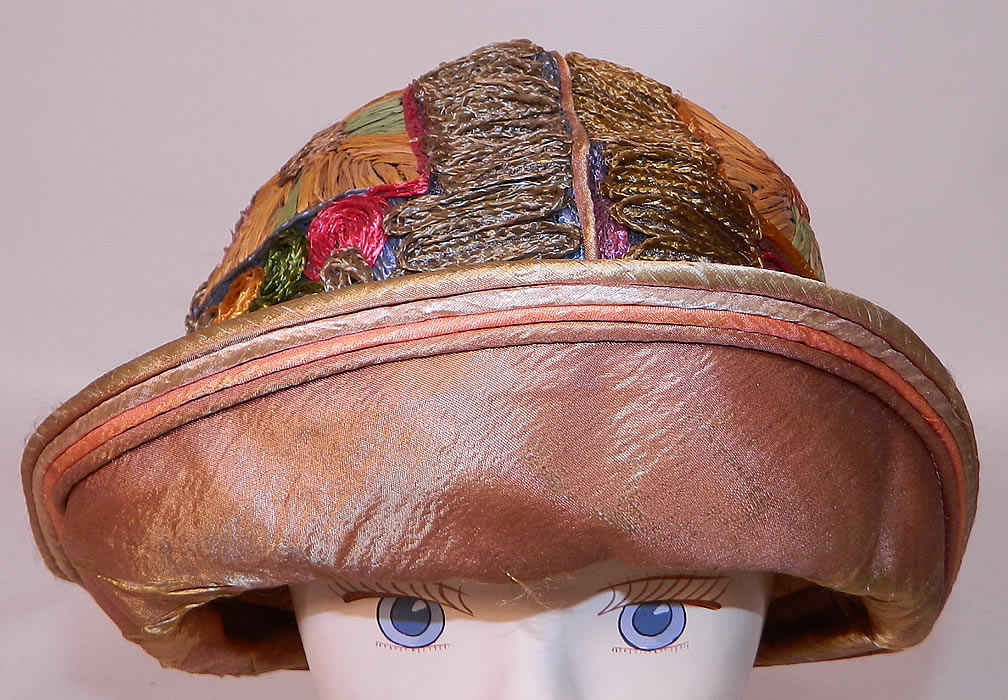 Vintage Colorful Straw Raffia Ribbon Work Embroidered Flapper Cloche Hat. It is made of a colorful straw and raffia done in a ribbon work embroidered technique covering the hat in a abstract geometric patchwork design.