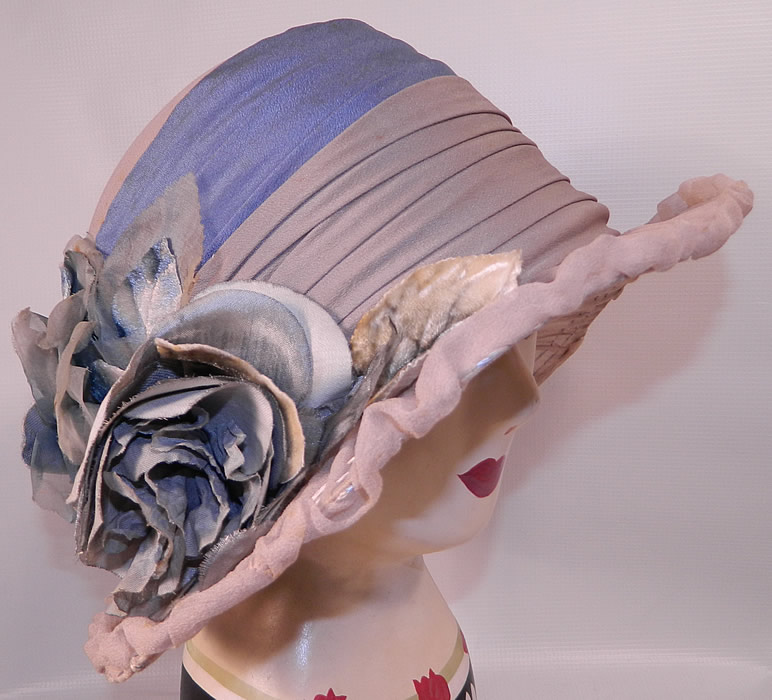 Vintage Maurice Importer Gray & Blue Silk Rose Flower Wide Brim Cloche Hat. This vintage Maurice Importer gray and blue silk rose flower wide brim cloche hat dates from the 1920s.