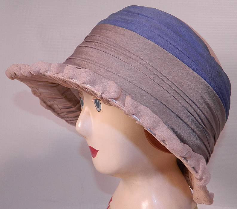 Vintage Maurice Importer Gray & Blue Silk Rose Flower Wide Brim Cloche Hat. This fabulous flapper cloche style  hat has a wired wide brim covered with a gray taupe sheer silk crepe pleated fabric and decorative stitching along the brim.
