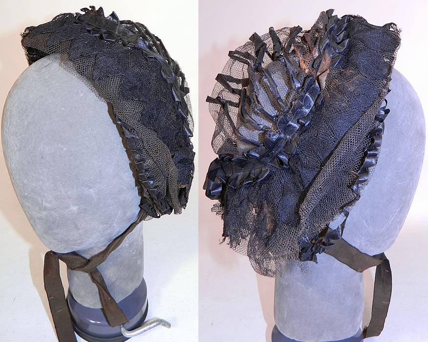 Victorian Civil War Era Black Net Ribbon Trim Mourning Bonnet Snood Headdress. It is made of a wired frame covered with a delicate fine sheer black net and black silk ribbon trim accents done in gathered loops and twisted stripes decorative designs.