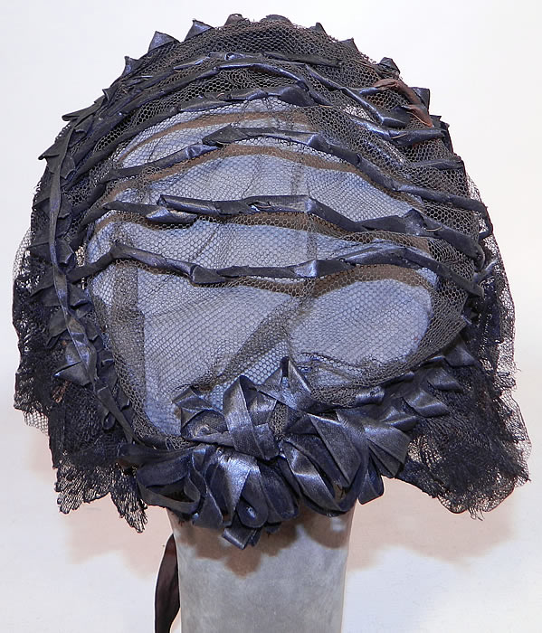 Victorian Civil War Era Black Net Ribbon Trim Mourning Bonnet Snood Headdress. This marvelous mourning bonnet snood style headdress has a sheer unlined crown, layered net front brim, ribbon trim back curtain and silk ribbon chin strap ties.