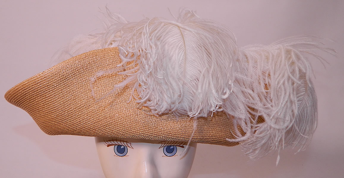 Edwardian Titanic Natural Straw Upturned Wide Brim White  Ostrich Feather Hat. This antique Titanic Edwardian era natural straw upturned wide brim white ostrich feather hat dates from 1912.