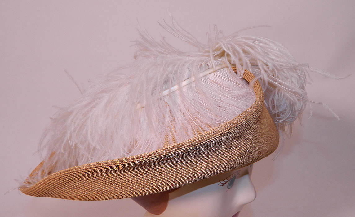 Edwardian Titanic Natural Straw Upturned Wide Brim White  Ostrich Feather Hat. This beautiful belle epoque grand summer hat has a wide upturned brim and would have sat atop a large full Gibson Girl style updo hairdo with hatpin.