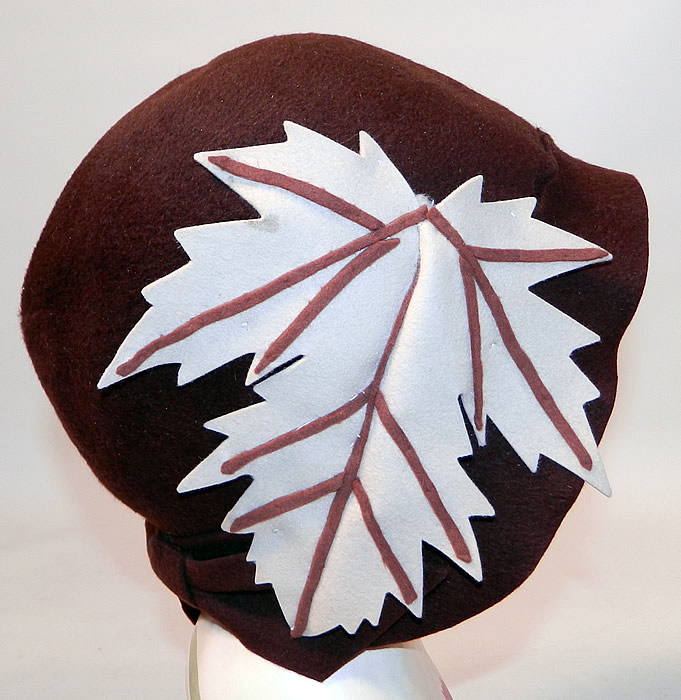 Vintage I Magnin & Co Brown Wool Felt Fall Maple Leaf Flapper Cloche Hat. The hat is made of brown wool felt fabric, with an off white cream color and brown wool felt applique maple leaf trim on the side.