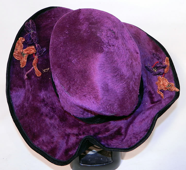 Edwardian Vintage Wolf Millinery Purple Velvet Flower Trim Wide Brim Hat. The hat is a large size measuring 23 inches inside crown circumference and 47 inches outside the brim.