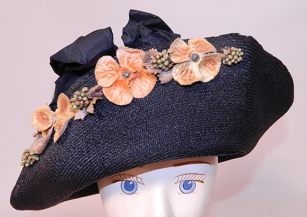 Edwardian Black Straw Orange Silk Velvet Floral Trim Upturned Wide Brim Hat. This vintage Edwardian era black straw orange silk velvet floral trim upturned wide brim hat dates from 1918.