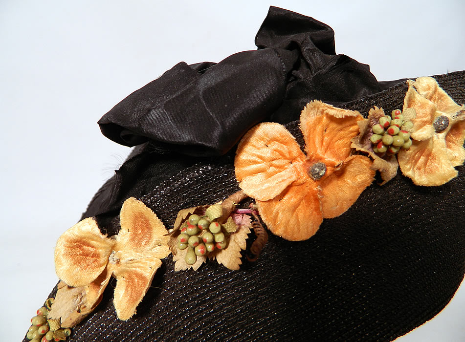 Edwardian Black Straw Orange Silk Velvet Floral Trim Upturned Wide Brim Hat.The hat measures 23 inches inside crown circumference.