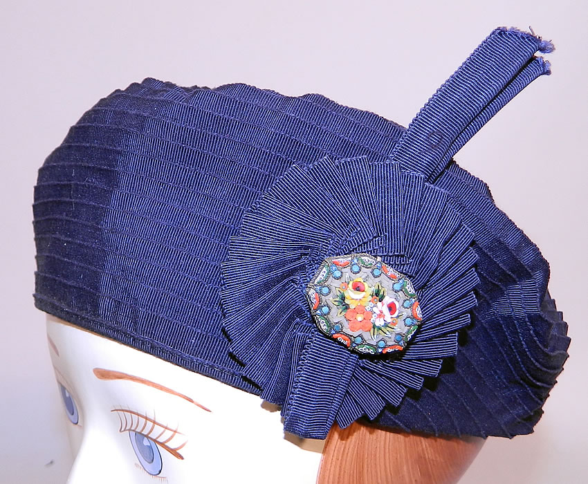Vintage Eva Mae Navy Blue Pleated Beret Tam Hat & Italian Micro Mosaic Brooch Pin. This vintage Eva Mae navy blue pleated beret tam hat and Italian micro mosaic brooch pin dates from the 1940s.