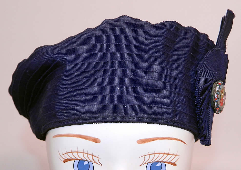 Vintage Eva Mae Navy Blue Pleated Beret Tam Hat & Italian Micro Mosaic Brooch Pin. It is made of a navy blue silk grosgrain ribbed textured fabric, with pleated ribbon work details.