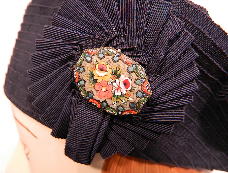 Vintage Eva Mae Navy Blue Pleated Beret Tam Hat & Italian Micro Mosaic Brooch Pin. There is a rosette trim on the side with an Italian micro mosaic brooch pin oval shaped with tiny flowers.