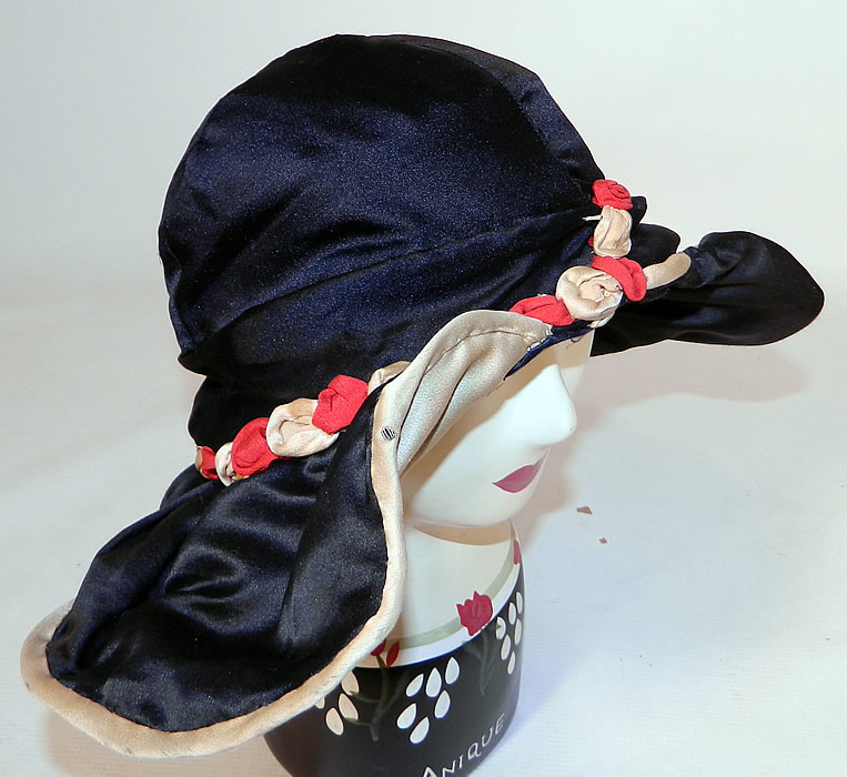Vintage Art Deco Black & White Silk Red Rosette Wired Wing Brim Flapper Cloche Hat. This fabulous flapper cloche style hat has a unique wired wing wide brim fanning out on either side creating a contrasting color oval shape.
