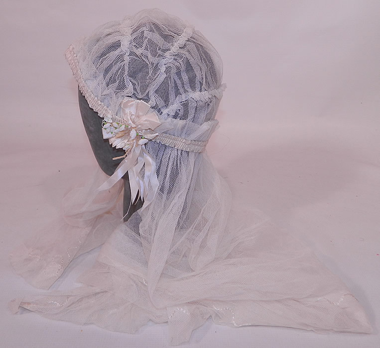 Vintage White Net Lace Silk Ribbon Bridal Bonnet Cap Headpiece Wedding Veil. There is cream silk ribbon ruched gathering trim around the cap, with rosette ribbon trim on the sides and tiny lily of the valley flowers.