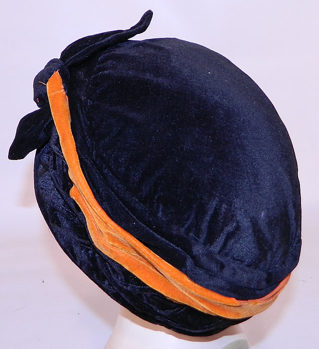 Vintage Art Deco Black & Orange Velvet Knotted Bow Trim Flapper Cloche Hat. This fabulous flapper cloche toque style hat is form fitting, brimless and fully lined inside.
