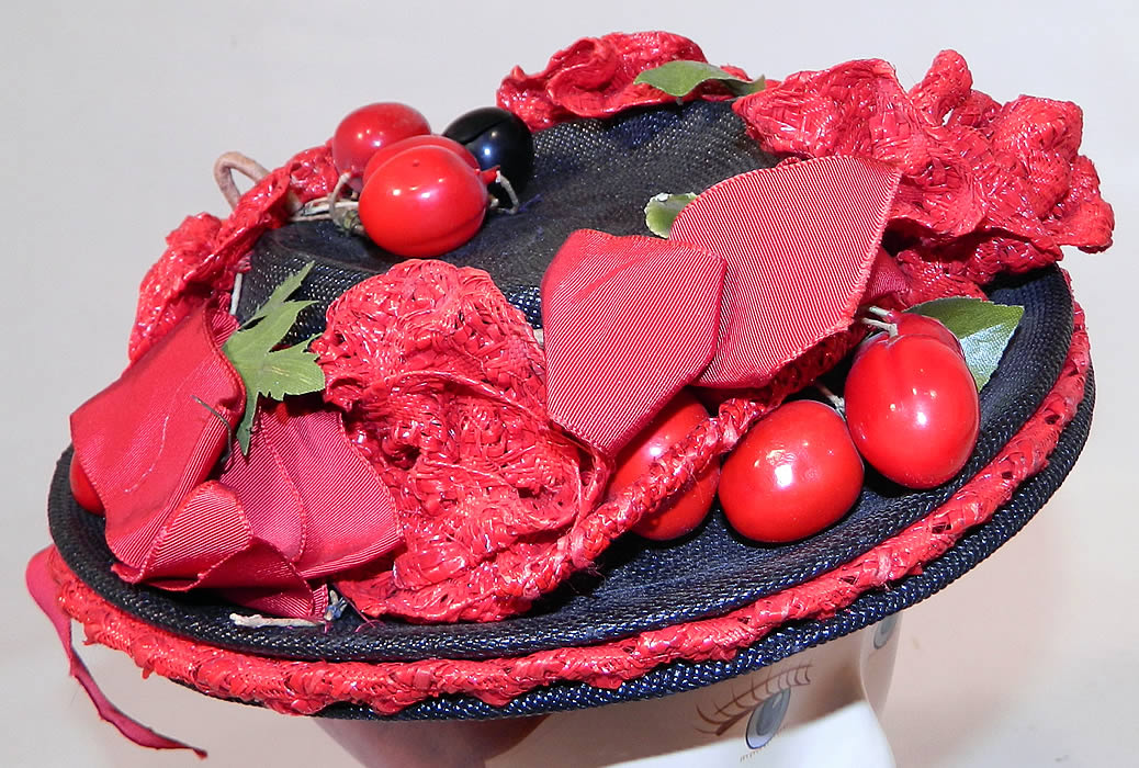 Vintage Red Straw Roses Cherries Small Skimmer Boater Tilt Hat Fascinator. This vintage red straw roses cherries small skimmer boater tilt hat fascinator dates from the 1940s.
