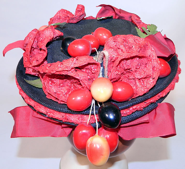 Vintage Red Straw Roses Cherries Small Skimmer Boater Tilt Hat Fascinator. The hat measures 21 inches in circumference inside the crown.