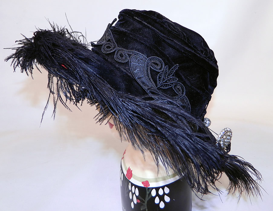 Edwardian Vintage Madame Gatecliff Modiste Black Velvet Lace Feather Trim Wide Brim Hat. This Edwardian era vintage Madame Gatecliff Modiste black velvet lace feather trim wide brim hat dates from 1918.