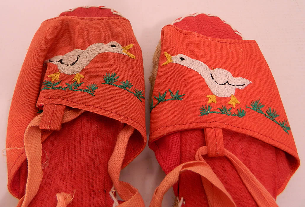 Vintage Red Linen Geese Ankle Tie Rope Sole Childrens Beach Sandal Shoes. They are made of a red linen fabric, with white embroidered geese duck designs on the front vamps.