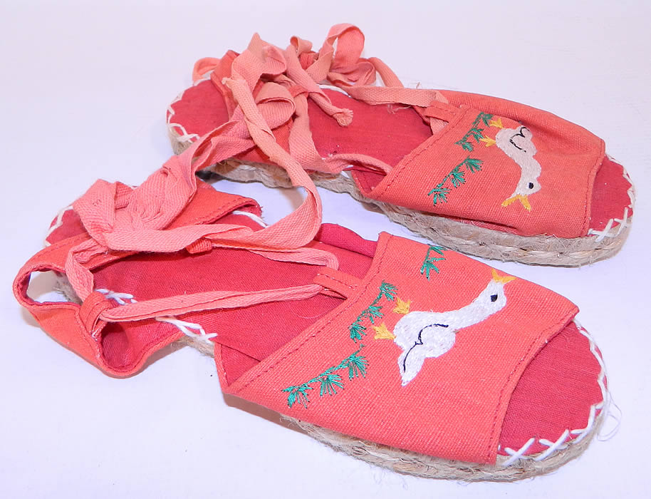 Vintage Red Linen Geese Ankle Tie Rope Sole Childrens Beach Sandal Shoes. These charming children's summertime beach sandal shoes have woven rope bottom soles, with heel caps, a red linen inside lining, white decorative cross stitching and red ribbon lacing ankle tie straps.