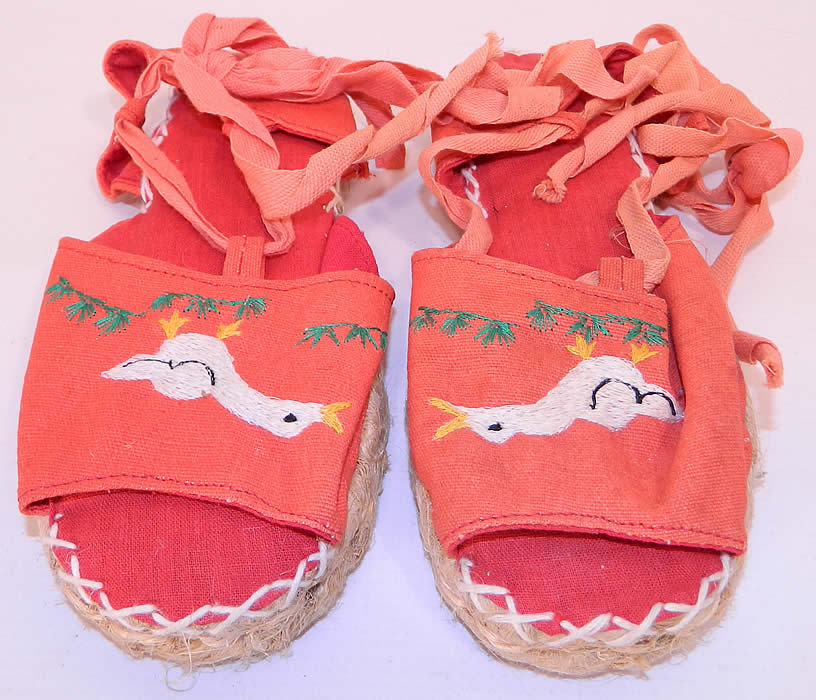 Vintage Red Linen Geese Ankle Tie Rope Sole Childrens Beach Sandal Shoes. This pair of vintage red linen geese ankle tie rope sole children's beach sandal shoes date from the 1940s.