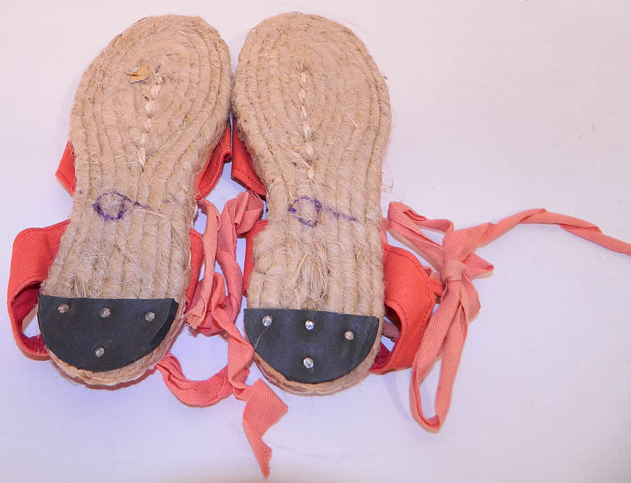Vintage Red Linen Geese Ankle Tie Rope Sole Childrens Beach Sandal Shoes.The shoes measure 8 1/2 inches long, 3 inches wide and are stamped on the bottom soles a size 9. They have never been worn and are in good unworn condition.