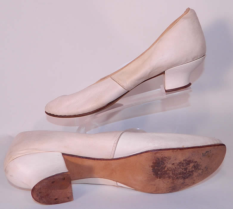 Victorian White Kid Leather Small Bridal Wedding Slippers Shoes Straight Sole. They are in good condition and have been gently worn, with only minor wear. These wonderful wedding style slippers are quality made!