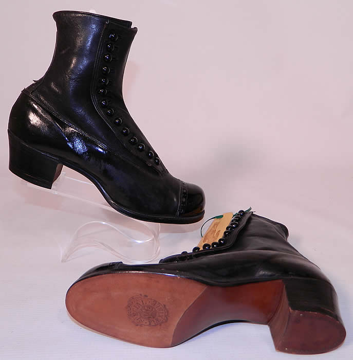 Victorian Unworn Vintage Welteze Shoes Black Leather High Button Boots. The boots have rounded toes, 14 black shoe buttons along the side for closure and stacked wooden cube heels.