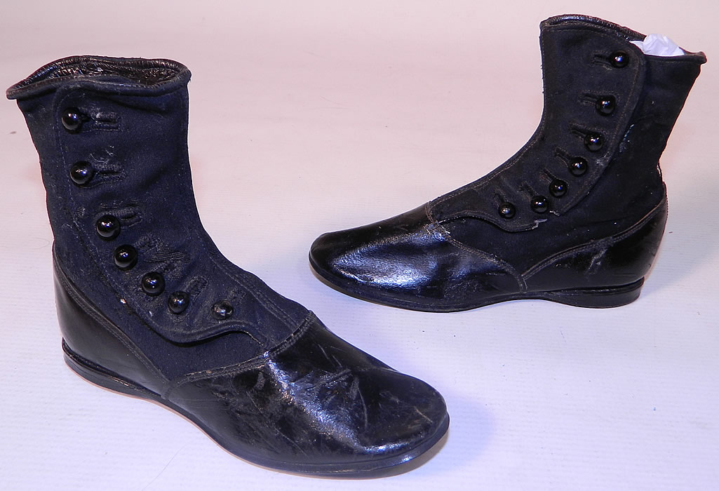 Victorian Black Wool Leather High Button Button Baby Boots Childs Shoes. This pair of antique Victorian era black wool and leather high button baby boots child's shoes date from 1890.