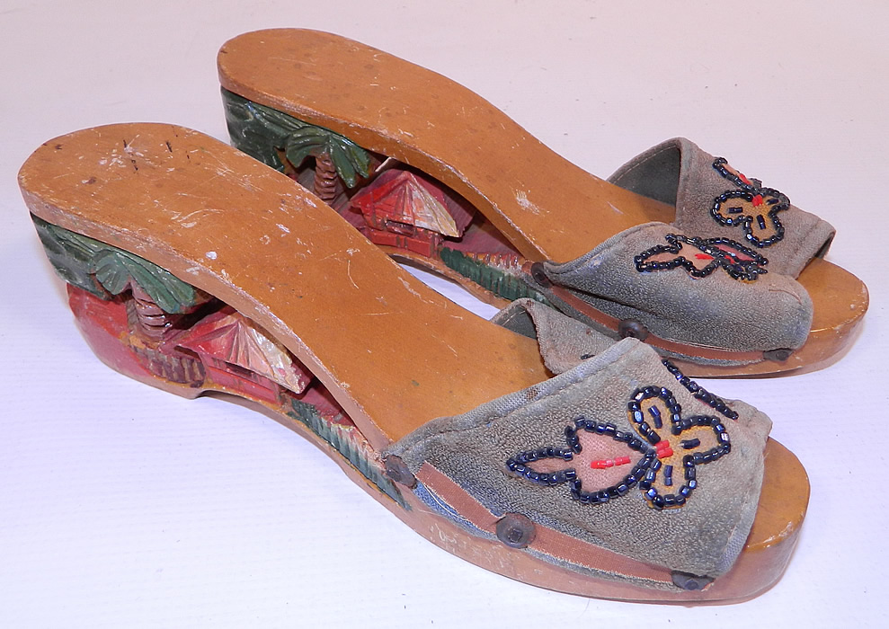 Vintage Philippines Hand Painted Carved Wooden Wedge Mules Sandal Shoes. These stunning sandal shoes have a backless mule slip on slipper style, open toes, a platform front and wedge heels. After the war, American GIs returned home from the Philippines with these shoes as gifts for their girlfriends and wives.