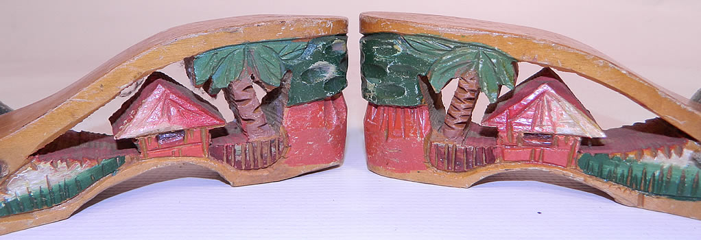 "Vintage Philippines Hand Painted Carved Wooden Wedge Mules Sandal Shoes. Each ""souvenir shoe"" contained a miniature scene inside its wooden heel. The shoes measure 8 1/2 inches long, 2 1/2 inches wide and have a 2 1/2 inch high heel."