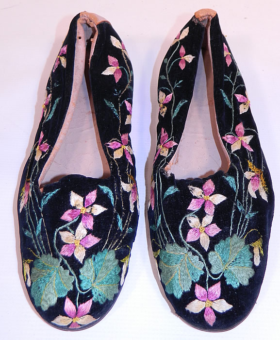 Victorian Black Velvet Violet Embroidered Men's Slipper Shoes. These stunning slip-on slipper style house shoes have pink leather lining inside and on the back trim, with hard leather soles and wooden stacked cube heels.