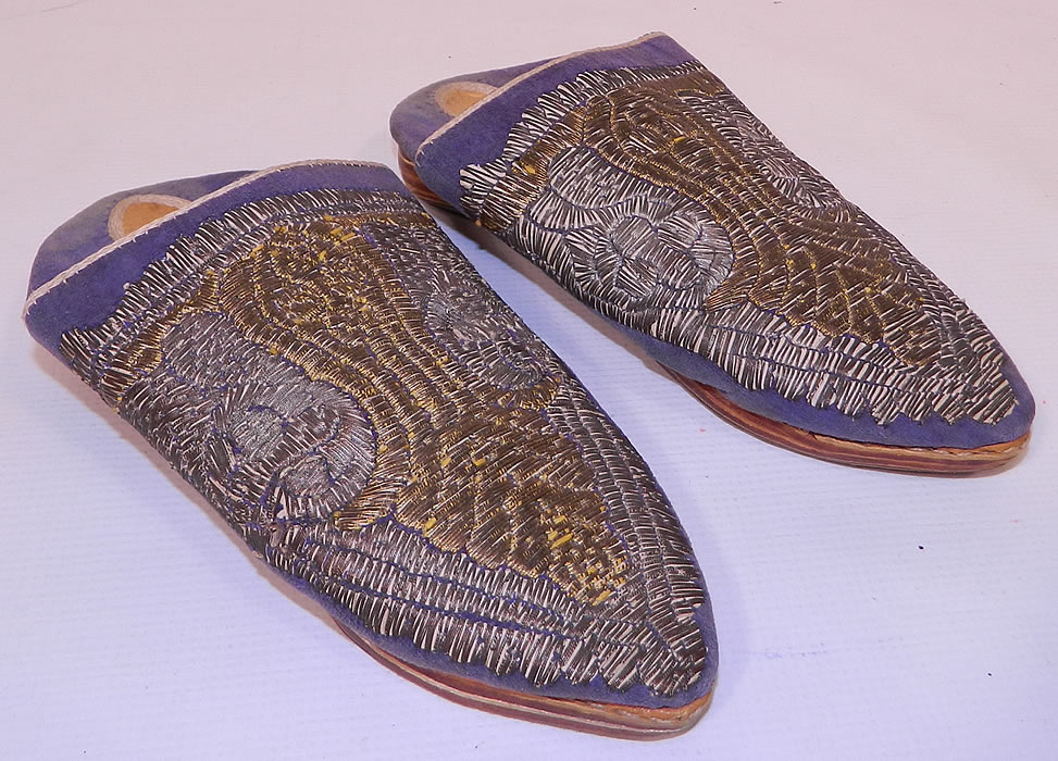 Vintage Moroccan Ladies Mules Cherbil Metal Embroidery Velvet Slipper Shoes. This pair of vintage Morocco ladies mules cherbil metal embroidery velvet slipper shoes date from the early 1900s. They are made of purple velvet, with hand embroidered gold and silver gilded wire thread embroidery couching needlework.