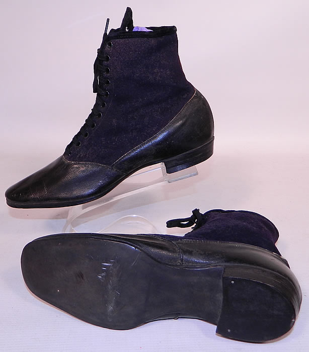 Victorian Black Leather Navy Blue Wool Winter High Top Lace-up Boots . There is black trim edging and laces for closure down the front, rounded toes, hard leather bottom soles and low stacked cube heels.