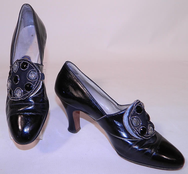 Vintage Mackey NY Black Leather Art Deco Beaded Buckle Flapper Shoes. These Art Deco flapper style shoes have a slip on style, with rounded toes and a modified boulevard heel. They have been gently worn and are in good wearable condition. These are truly a wonderful quality made Art Deco shoe!