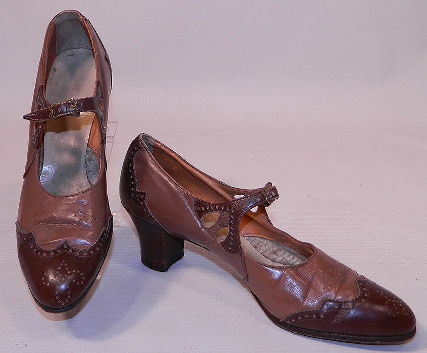 Vintage Two Tone Punchwork Brown Leather Buckle Strap Mary Jane Shoes. These women's Mary Janes style shoes have adjustable buckle straps across the instep vamps, with eyelet cutouts on the sides and wooden stacked cube heels.