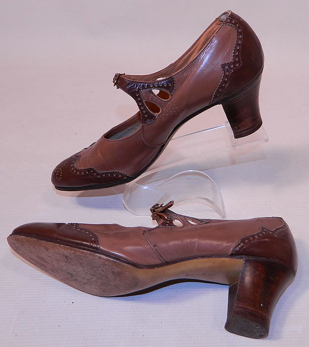 Vintage Two Tone Punchwork Brown Leather Buckle Strap Mary Jane Shoes. The shoes measure 10 1/2 inches long, 2 3/4 inches wide, with 2 1/2 inch high heels. They have  been gently worn and are in good condition. These are truly a wonderful piece of wearable Art Deco shoe art!