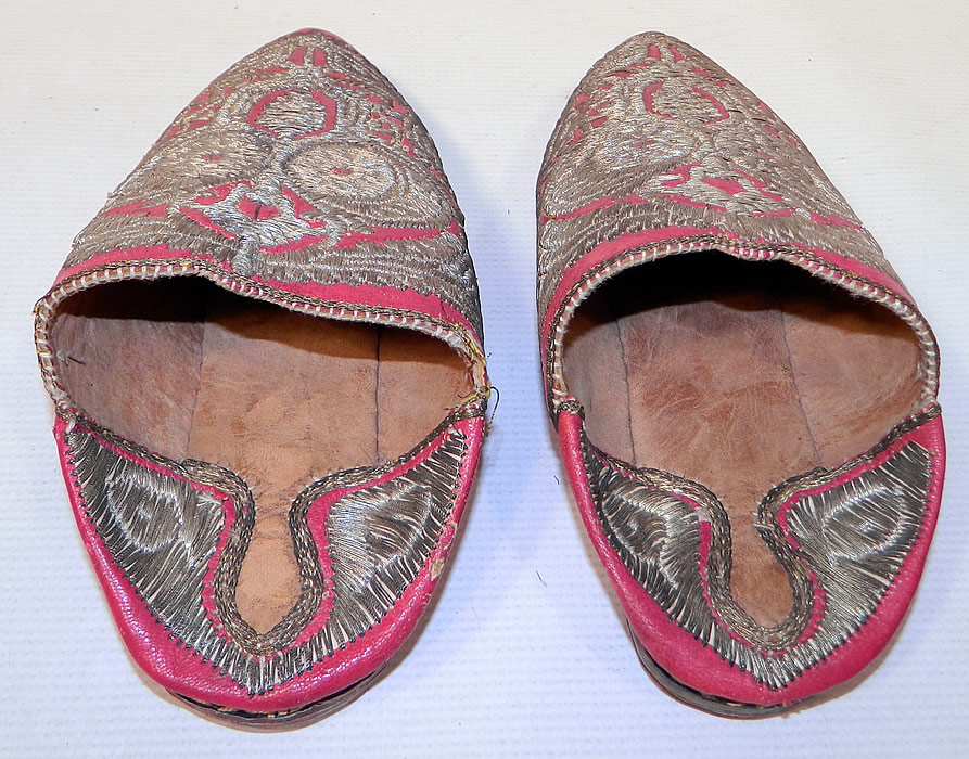 Vintage Moroccan Ladies Mules Cherbil Metal Embroidery Red Leather Slipper Shoes. The shoes measure 10 inches long and 3 inches wide. They are in good condition and have been gently worn.
