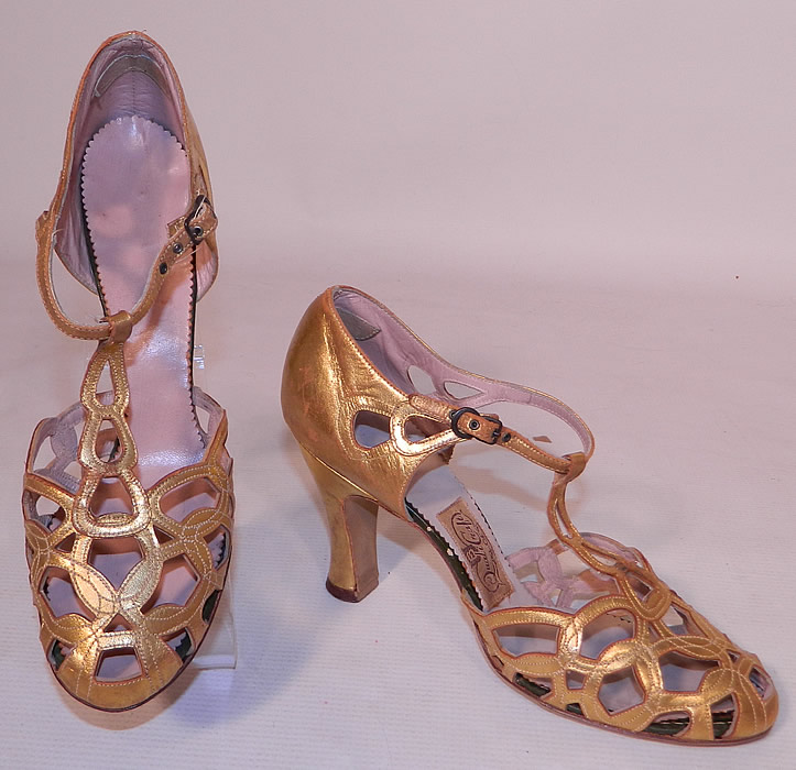 Vintage Quali Craft Art Deco Gold Leather Ring Chain Link Lattice T-Strap Shoes. These elegant evening shoes have a T-strap style, with decorative chain link latticework interlocking circular ring cut out peek-a-boo designs on the front instep vamps toes, with adjustable ankle straps buckle closures and modified boulevard high heels.